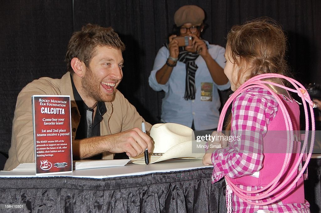 <a gi-track='captionPersonalityLinkClicked' href=/galleries/search?phrase=Brett+Eldredge&family=editorial&specificpeople=7334271 ng-click='$event.stopPropagation()'>Brett Eldredge</a> signs autographs at Cowboy FanFest during the Wrangler National Finals Rodeo at the Las Vegas Convention Center on December 15, 2012 in Las Vegas, Nevada.