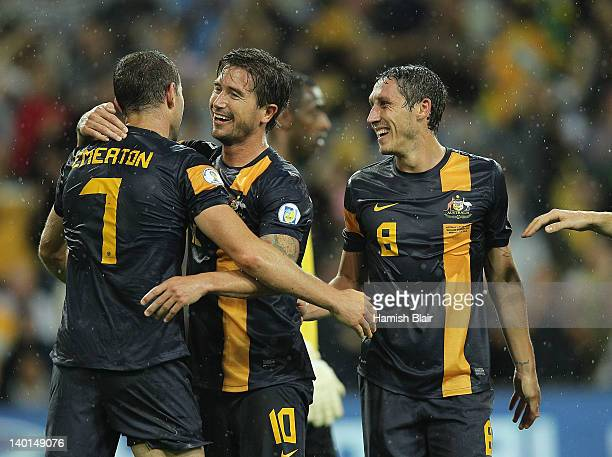 Brett Emerton Harry Kewell and Mark Milligan of Australia celebrate their fourth goal during the Group D 2014 FIFA World Cup Asian Qualifier match...