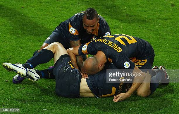 Brett Emerton of Australia celebrates his goal with teammates during the Group D 2014 FIFA World Cup Asian Qualifier match between Australia and...