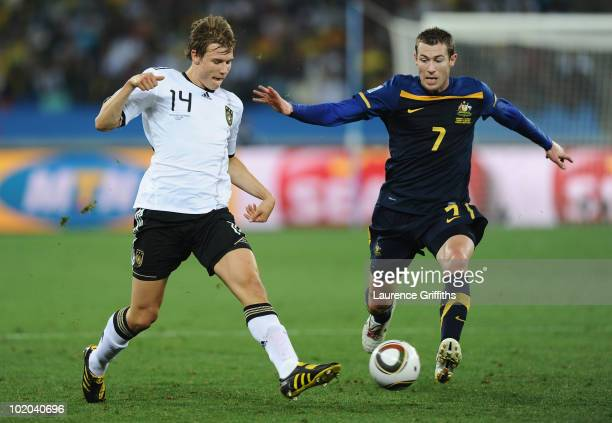 Brett Emerton of Australia chases Holger Badstuber of Germany during the 2010 FIFA World Cup South Africa Group D match between Germany and Australia...