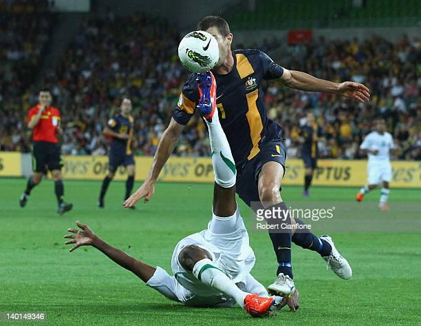 Brett Emerton of Australia is challenged by Kamil Saddiq of Saudi Arabia during the Group D 2014 FIFA World Cup Asian Qualifier match between...
