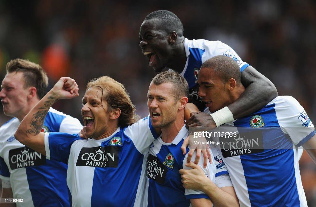 <a gi-track='captionPersonalityLinkClicked' href=/galleries/search?phrase=Brett+Emerton&family=editorial&specificpeople=206493 ng-click='$event.stopPropagation()'>Brett Emerton</a> of Blackburn celebrates scoring to make it 2-0 with team mates <a gi-track='captionPersonalityLinkClicked' href=/galleries/search?phrase=Michel+Salgado&family=editorial&specificpeople=209291 ng-click='$event.stopPropagation()'>Michel Salgado</a>, <a gi-track='captionPersonalityLinkClicked' href=/galleries/search?phrase=Christopher+Samba&family=editorial&specificpeople=739114 ng-click='$event.stopPropagation()'>Christopher Samba</a> and <a gi-track='captionPersonalityLinkClicked' href=/galleries/search?phrase=Martin+Olsson&family=editorial&specificpeople=4185617 ng-click='$event.stopPropagation()'>Martin Olsson</a> during the Barclays Premier League match between Wolverhampton Wanderers and Blackburn Rovers at Molineux on May 22, 2011 in Wolverhampton, England.