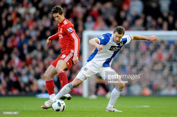 Brett Emerton of Blackburn Rovers challenges Fernando Torres of Liverpool during the Barclays Premier League match between Liverpool and Blackburn...