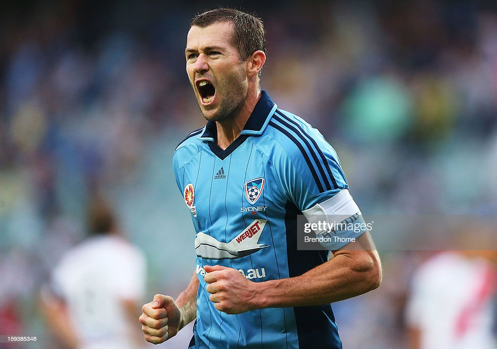<a gi-track='captionPersonalityLinkClicked' href=/galleries/search?phrase=Brett+Emerton&family=editorial&specificpeople=206493 ng-click='$event.stopPropagation()'>Brett Emerton</a> of Sydney celebrates after scoring the opening goal for Sydney during the round 16 A-League match between Sydney FC and the Melbourne Heart at Allianz Stadium on January 13, 2013 in Sydney, Australia.