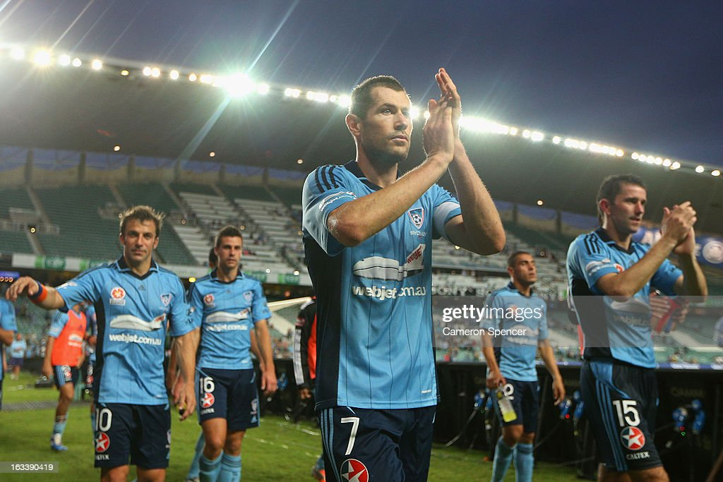 Brett Emerton of Sydney FC and team mates thank fans after winning the round 24 A-League match between Sydney FC and the Central Coast Mariners at Allianz Stadium on March 9, 2013 in Sydney, Australia.
