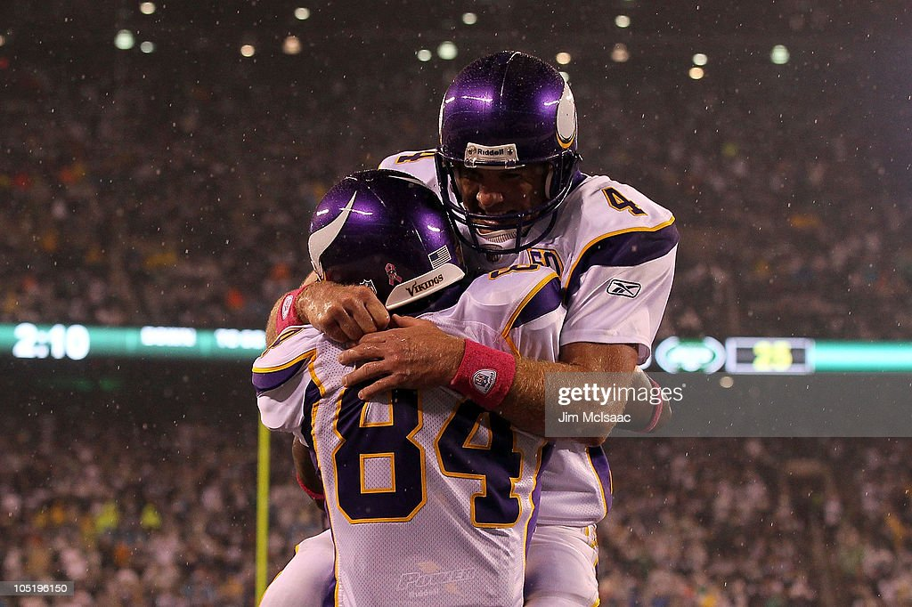 Brett Favre and Randy Moss of the Minnesota Vikings celebrate after Moss caught a 37yard touchdown pass from Favre in the third quarter against the...