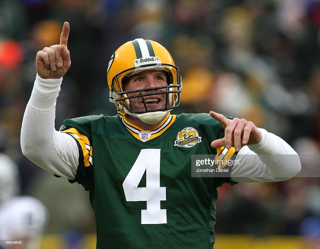 Brett Favre of the Green Bay Packers celebrates a touchdown pass against the Oakland Raiders on December 9 2007 at Lambeau Field in Green Bay...