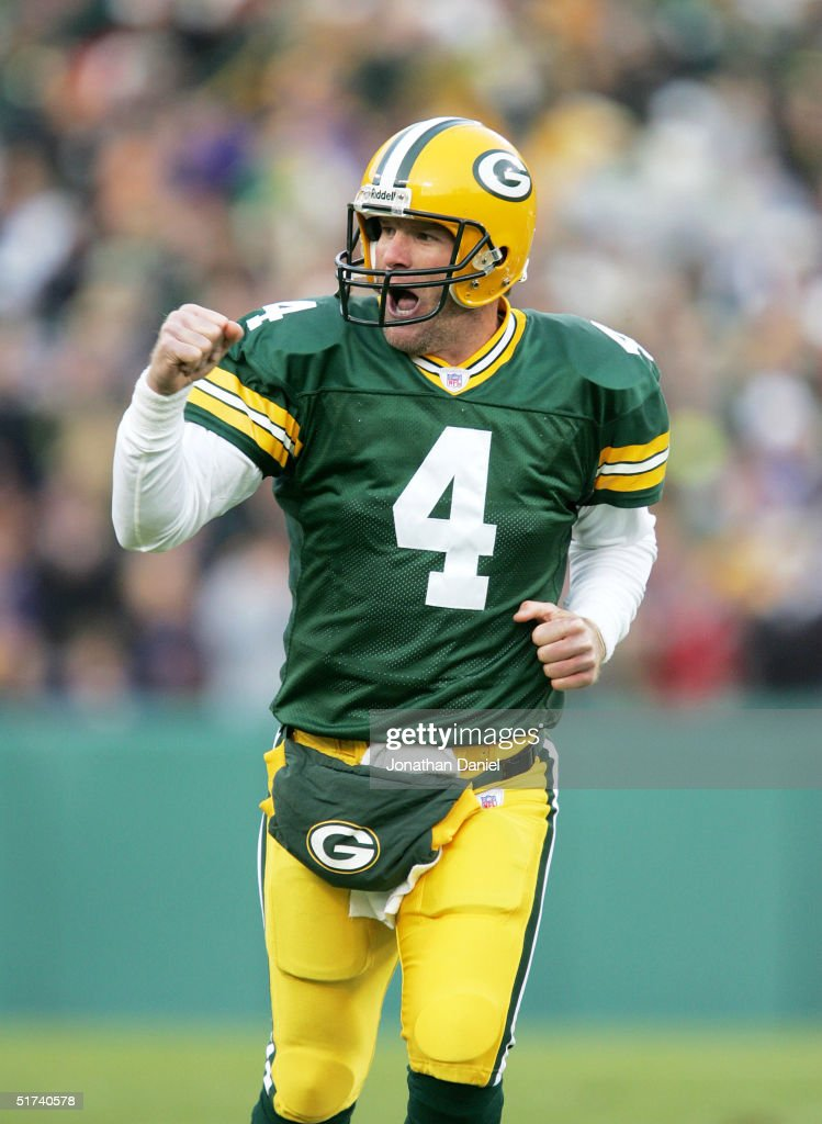 Brett Favre of the Green Bay Packers celebrates after completing a touchdown pass against the Minnesota Vikings during a game at Lambeau Field on...