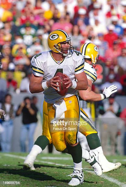 Brett Favre of the Green Bay Packers drops back to pass against the Tampa Bay Buccaneers during an NFL football game at Tampa Stadium December 7 1997...