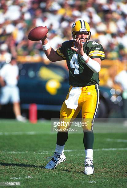 Brett Favre of the Green Bay Packers drops back to pass against the Tampa Bay Buccaneers during an NFL football game at Lambeau Field October 5 1997...
