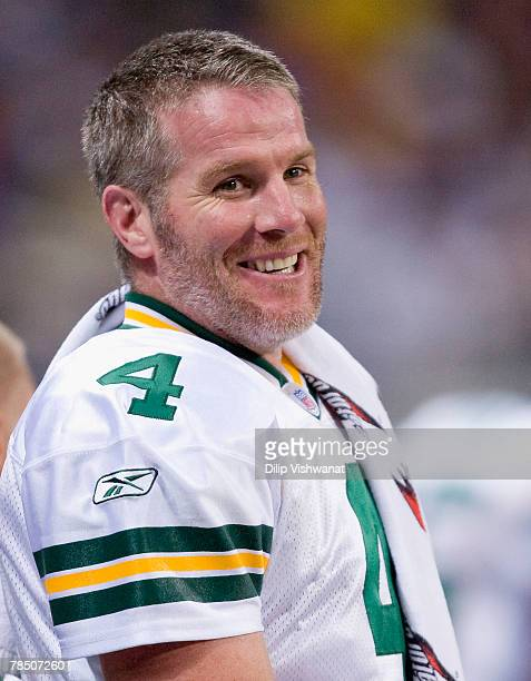 Brett Favre of the Green Bay Packers laughs while on the sideline against the St Louis Rams at the Edward Jones Dome December 16 2007 in St Louis...