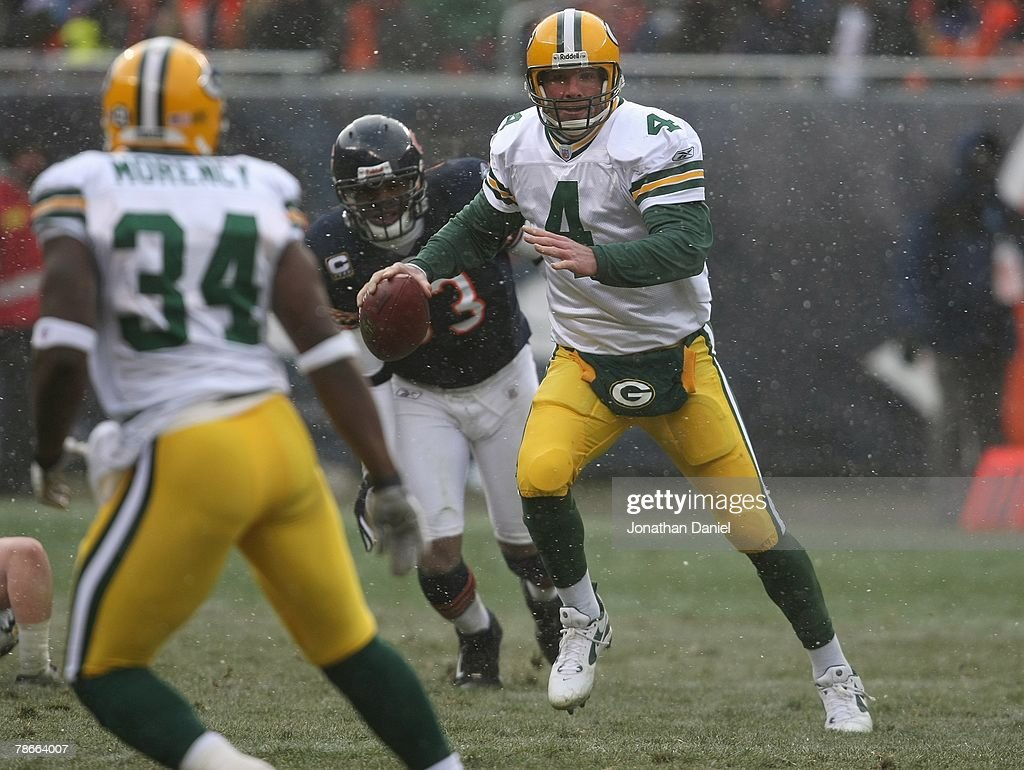 Brett Favre #4 of the Green Bay Packers looks for an open receiver during the game against the Chicago Bears on December 23, 2007 at Soldier Field in Chicago, Illinois. The Bears defeated the Packers 35-7.