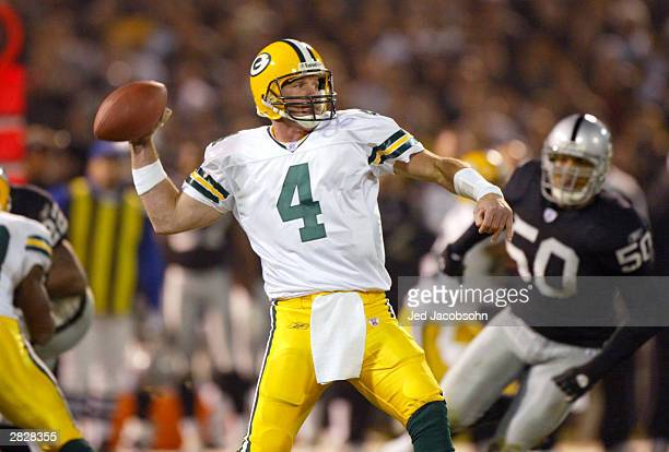 Brett Favre of the Green Bay Packers passes against the Oakland Raiders December 22 2003 at the Network Associates Coliseum in Oakland California