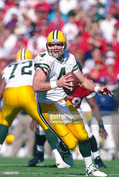 Brett Favre of the Green Bay Packers rolls out to pass against the Tampa Bay Buccaneers during an NFL football game at Tampa Stadium December 7 1997...