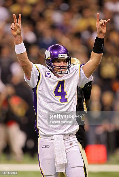 Brett Favre of the Minnesota Vikings celebrates throwing for a touchdown in the first quarter against the New Orleans Saints during the NFC...
