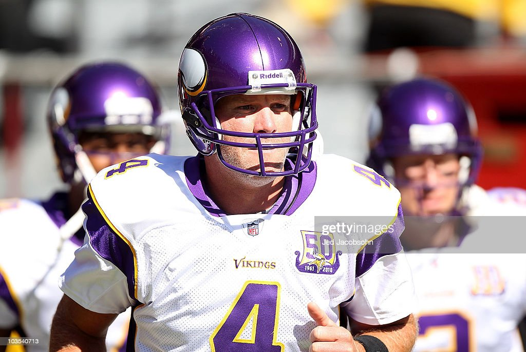 Brett Favre #4 of the Minnesota Vikings enters the field for warm ups against the San Francisco 49er during an NFL pre-season game at Candlestick Park on August 22, 2010 in San Francisco, California.