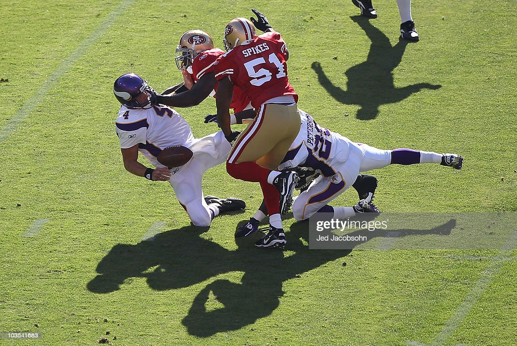 Brett Favre #4 of the Minnesota Vikings is sacked by Patrick Willis #52 and Takeo Spikes #51 of the San Francisco 49ers during an NFL pre-season game at Candlestick Park on August 22, 2010 in San Francisco, California.