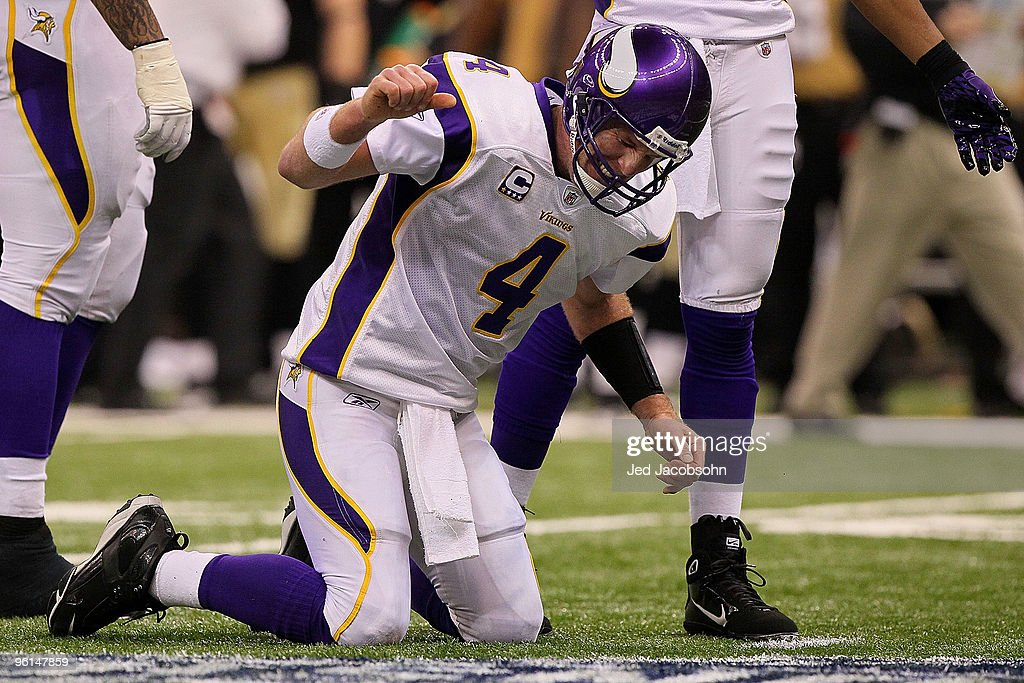 <a gi-track='captionPersonalityLinkClicked' href=/galleries/search?phrase=Brett+Favre&family=editorial&specificpeople=167102 ng-click='$event.stopPropagation()'>Brett Favre</a> #4 of the Minnesota Vikings reacts after taking a hard hit in the second half against the New Orleans Saints during the NFC Championship Game at the Louisiana Superdome on January 24, 2010 in New Orleans, Louisiana.
