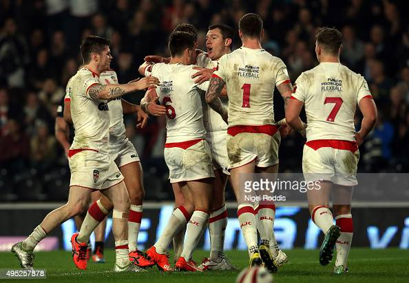 Brett Ferres of England celebrates scoring a try with teamates during the International Rugby League Test Series match between England and New...