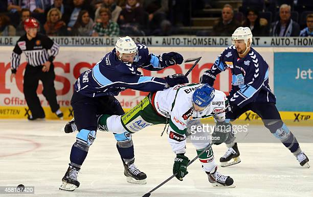Brett Festerling of Hamburg Freezers battles for the puck with Daniel DaSilva of Augsburger Panther during the DEL game between Hamburg Freezers and...