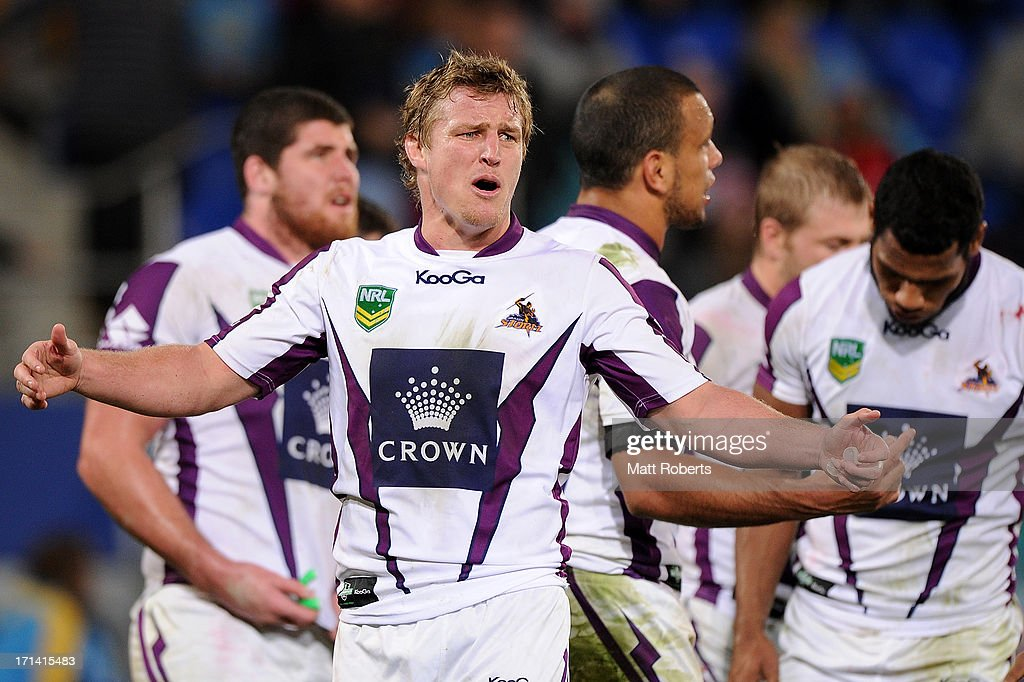 <a gi-track='captionPersonalityLinkClicked' href=/galleries/search?phrase=Brett+Finch&family=editorial&specificpeople=207179 ng-click='$event.stopPropagation()'>Brett Finch</a> of the Storm reacts during the round 15 NRL match between the Gold Coast Titans and the Melbourne Storm at Skilled Park on June 24, 2013 on the Gold Coast, Australia.