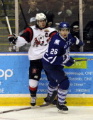 Brett Foy of the Mississauga Steelheads and Luke Mercer the Niagara IceDogs battle on the boards during game action on February 23 2014 at the...