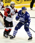 Brett Foy of the Mississauga Steelheads fights for space with Luke Mercer the Niagara IceDogs during game action on February 23 2014 at the Hershey...