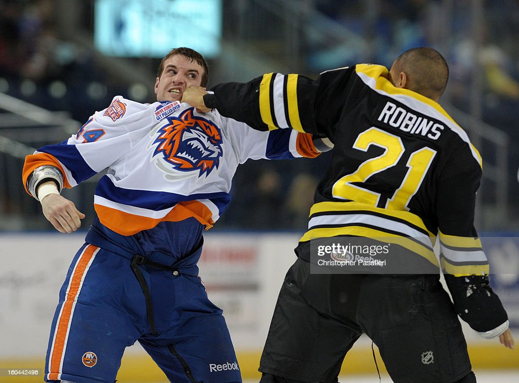 Brett Gallant #44 of the Bridgeport Sound Tigers and Bobby Robins #21 of the Providence Bruins fight during an American Hockey League game on January 31, 2013 at the Webster Bank Arena at Harbor Yard in Bridgeport, Connecticut.