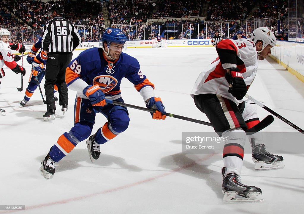 Brett Gallant #59 of the New York Islanders skates against the Ottawa Senators at the Nassau Veterans Memorial Coliseum on April 8, 2014 in Uniondale, New York.