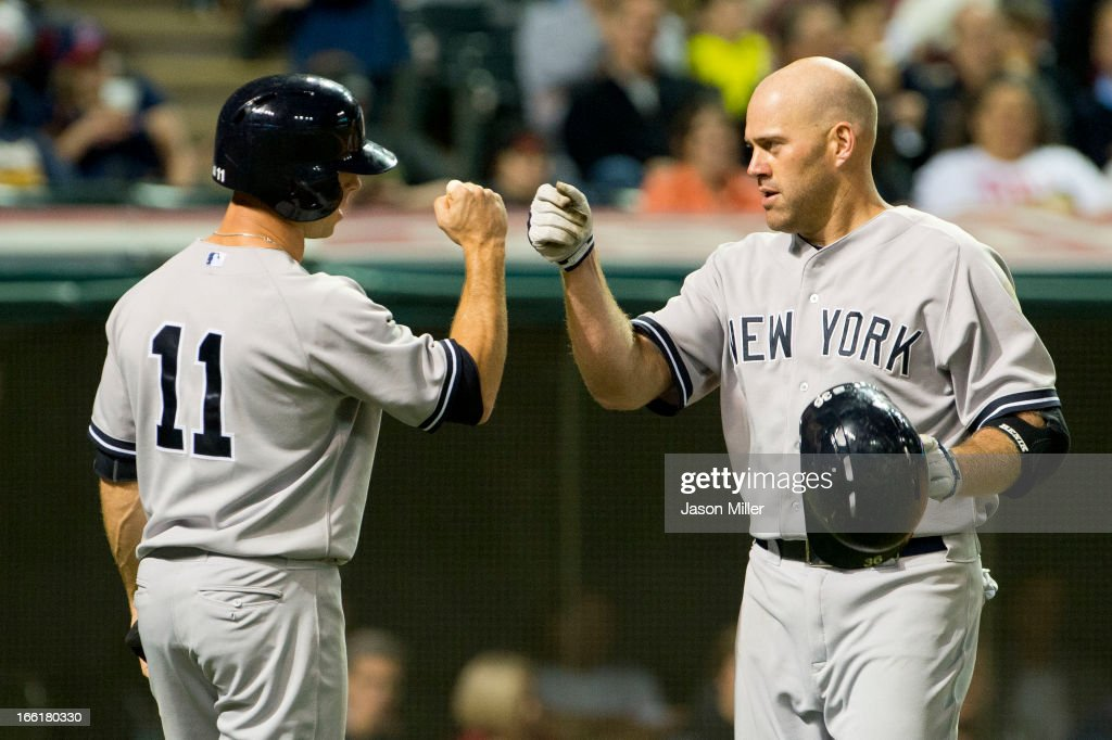 Brett Gardner #11 celebrates with Kevin Youkilis #36 of the New York Yankees after Youkilis hit a two run home run during the sixth inning against the Cleveland Indians at Progressive Field on April 9, 2013 in Cleveland, Ohio.