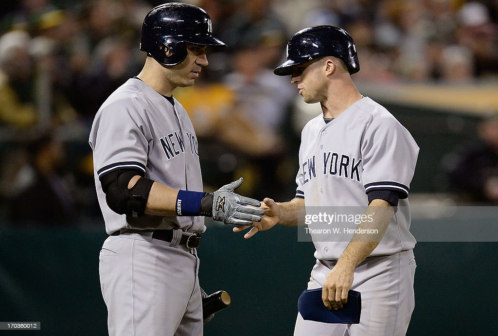 <a gi-track='captionPersonalityLinkClicked' href=/galleries/search?phrase=Brett+Gardner&family=editorial&specificpeople=4172518 ng-click='$event.stopPropagation()'>Brett Gardner</a> #11 (R) is congratulated by <a gi-track='captionPersonalityLinkClicked' href=/galleries/search?phrase=Travis+Hafner&family=editorial&specificpeople=220556 ng-click='$event.stopPropagation()'>Travis Hafner</a> #33 after Gardner scored in the eighth inning against the Oakland Athletics at O.co Coliseum on June 11, 2013 in Oakland, California.