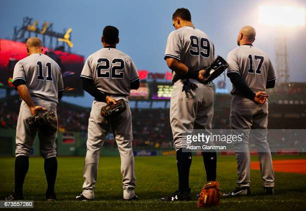 Brett Gardner Jacoby Ellsbury Aaron Judge and Matt Holliday of the New York Yankees looks on during the National Anthem before a game against the...