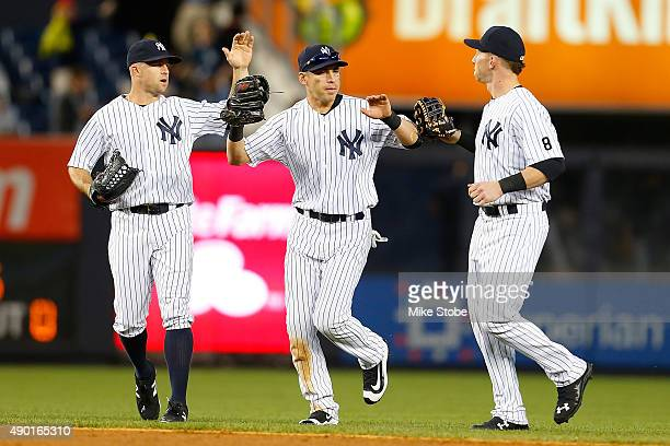 Brett Gardner Jacoby Ellsbury and Slade Heathcott of the New York Yankees celebrate after defeating the Chicago White Sox at Yankee Stadium on...