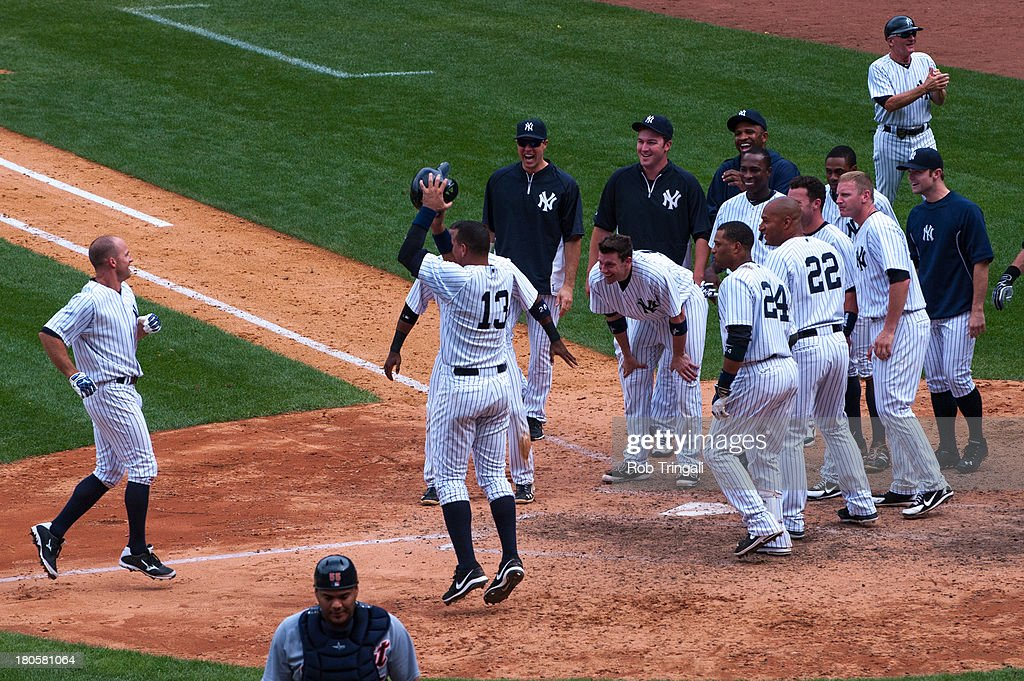 Brett Gardner #11 of the New York Yankees and his teammates celebrate his game winning home run in the bottom of the 9th inning against the Detroit Tigers at Yankee Stadium on August 11, 2013 in the Bronx borough of Manhattan.