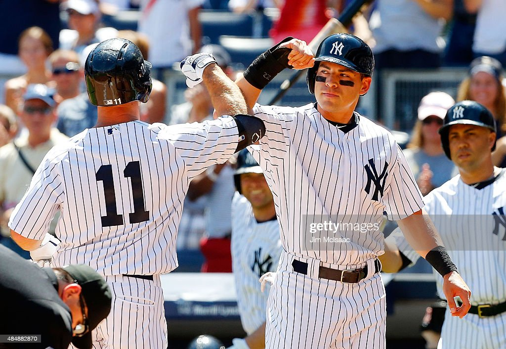 <a gi-track='captionPersonalityLinkClicked' href=/galleries/search?phrase=Brett+Gardner&family=editorial&specificpeople=4172518 ng-click='$event.stopPropagation()'>Brett Gardner</a> #11 of the New York Yankees celebrates his first inning two-run home run against the Cleveland Indians with teammate <a gi-track='captionPersonalityLinkClicked' href=/galleries/search?phrase=Jacoby+Ellsbury&family=editorial&specificpeople=4172583 ng-click='$event.stopPropagation()'>Jacoby Ellsbury</a> #22 at Yankee Stadium on August 22, 2015 in the Bronx borough of New York City.