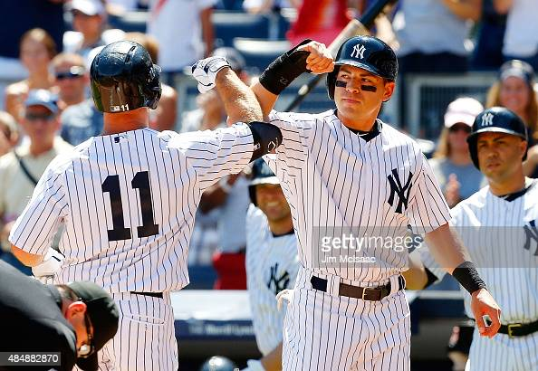 Brett Gardner of the New York Yankees celebrates his first inning tworun home run against the Cleveland Indians with teammate Jacoby Ellsbury at...