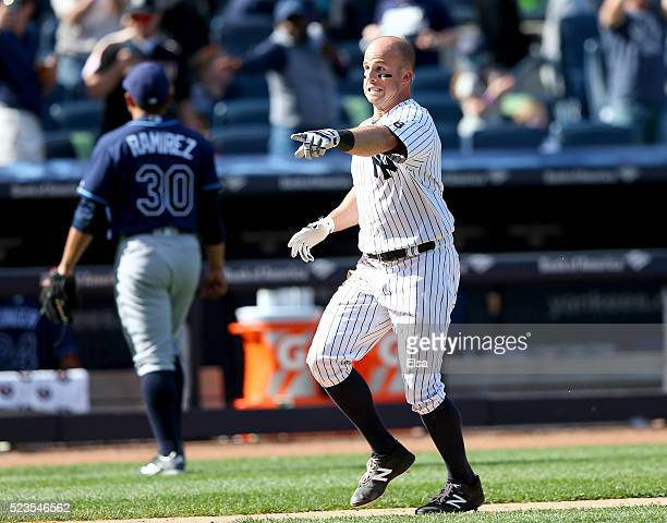 Brett Gardner of the New York Yankees celebrates his walkoff home run to win the game as Erasmo Ramirez of the Tampa Bay Rays walks off the field at...