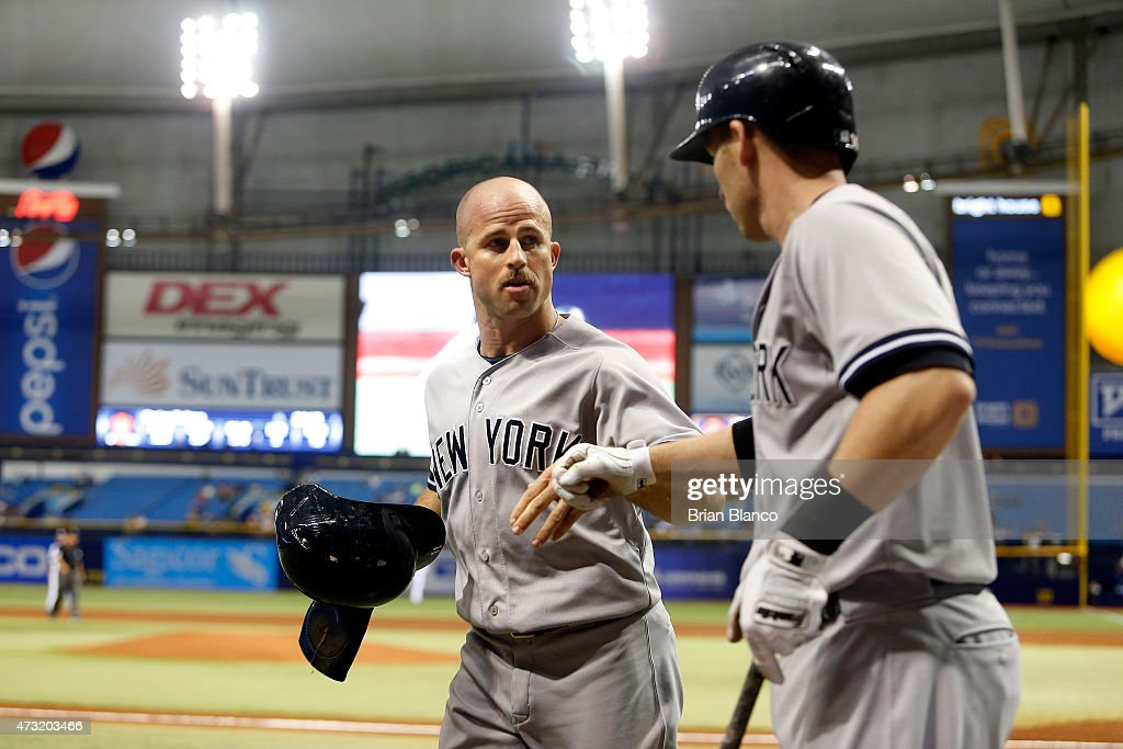 Brett Gardner #11 of the New York Yankees (left) celebrates with Stephen Drew #14 after scoring off of a single by Brian McCann #34 during the first inning of a game against the Tampa Bay Rays on May 13, 2015 at Tropicana Field in St. Petersburg, Florida.