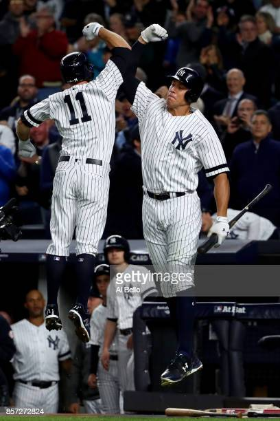 Brett Gardner of the New York Yankees celebrates with teammate Aaron Judge after hitting a home run against Ervin Santana of the Minnesota Twins...