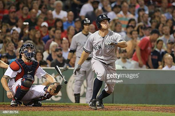 Brett Gardner of the New York Yankees connects for a home run against the Boston Red Sox in the eighth inning at Fenway Park on September 1 2015 in...