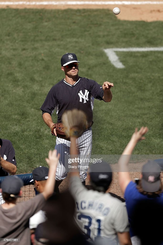 Brett Gardner #11 of the New York Yankees flips a ball to fans following the sixth inning of a game against the Boston Red Sox at George M. Steinbrenner Field on March 18, 2014 in Tampa, Florida.