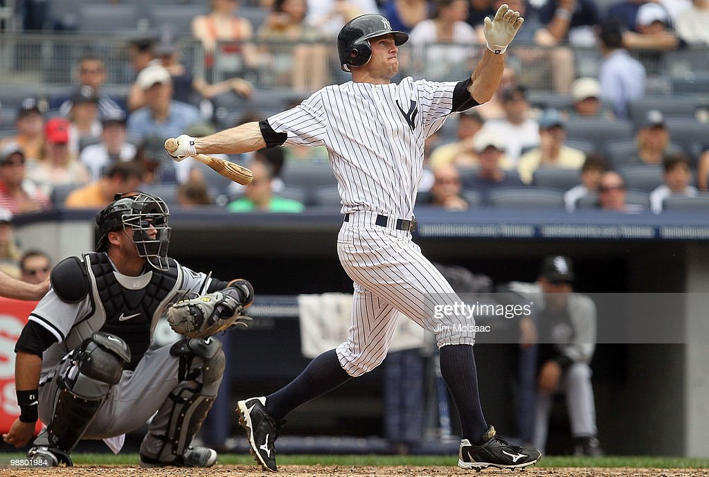 Brett Gardner #11 of the New York Yankees follows through on a fourth inning home run against the Chicago White Sox on May 2, 2010 at Yankee Stadium in the Bronx borough of New York City. The Yankees defeated the White Sox 12-3.