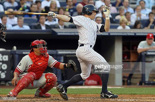 Brett Gardner of the New York Yankees follows through on a second inning two run triple against the Philadelphia Phillies on June 15 2010 at Yankee...