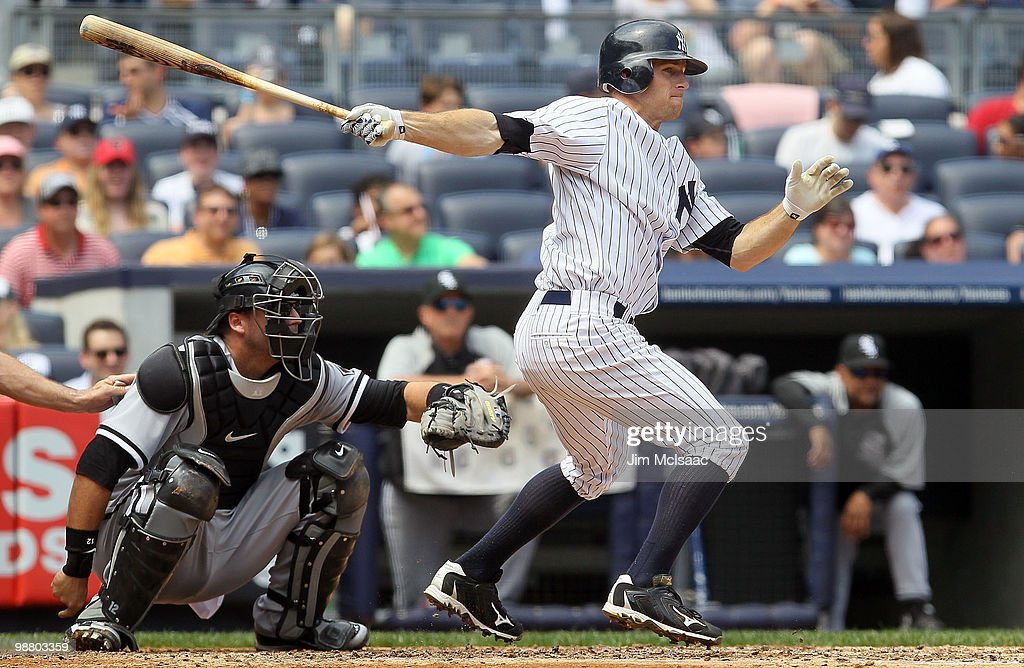 <a gi-track='captionPersonalityLinkClicked' href=/galleries/search?phrase=Brett+Gardner&family=editorial&specificpeople=4172518 ng-click='$event.stopPropagation()'>Brett Gardner</a> #11 of the New York Yankees follows through on a second inning RBI single against the Chicago White Sox on May 2, 2010 at Yankee Stadium in the Bronx borough of New York City. The Yankees defeated the White Sox 12-3.
