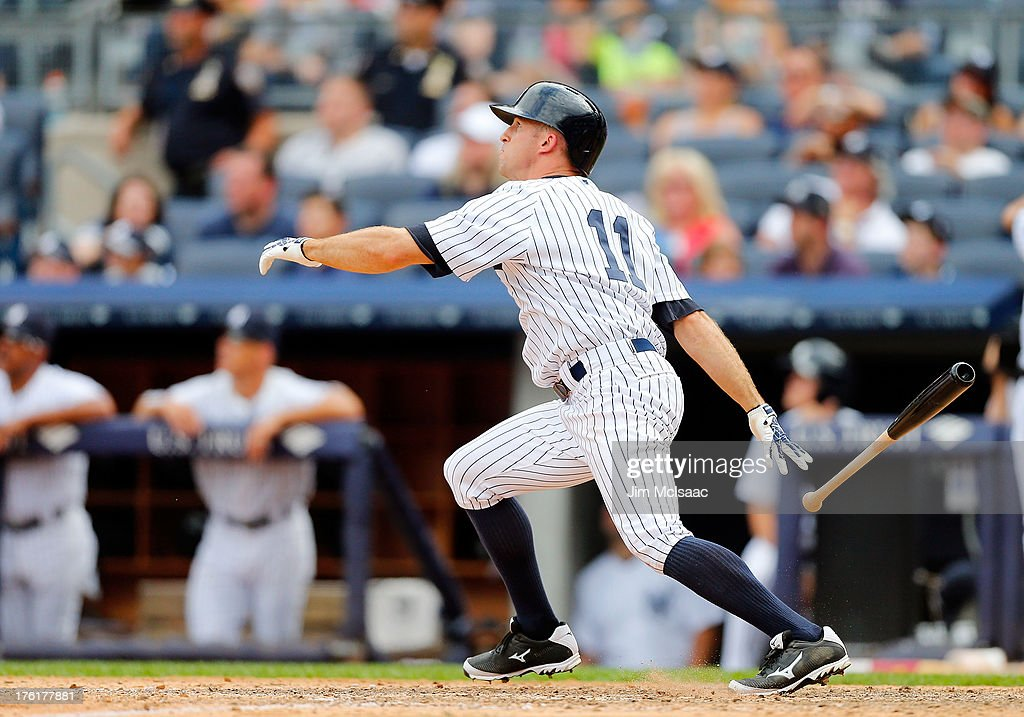<a gi-track='captionPersonalityLinkClicked' href=/galleries/search?phrase=Brett+Gardner&family=editorial&specificpeople=4172518 ng-click='$event.stopPropagation()'>Brett Gardner</a> #11 of the New York Yankees follows through on his ninth inning game winning home run against the Detroit Tigers at Yankee Stadium on August 11, 2013 in the Bronx borough of New York City.