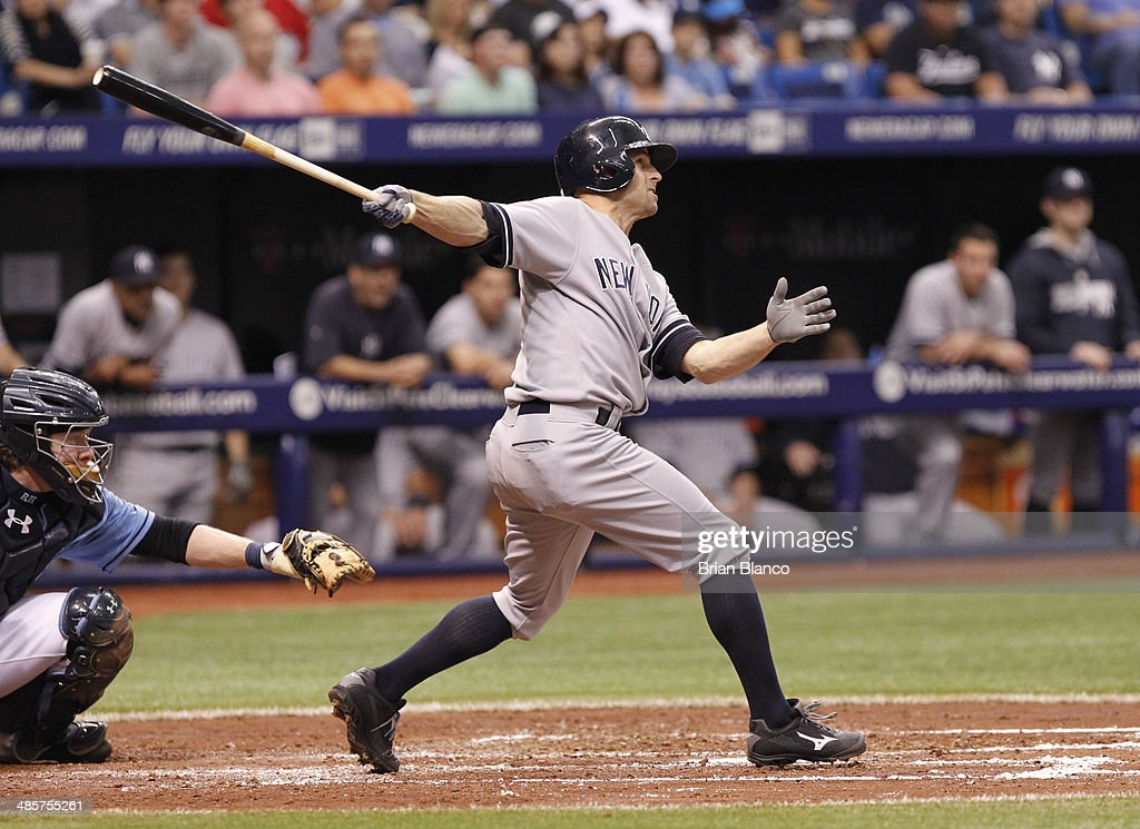 <a gi-track='captionPersonalityLinkClicked' href=/galleries/search?phrase=Brett+Gardner&family=editorial&specificpeople=4172518 ng-click='$event.stopPropagation()'>Brett Gardner</a> #11 of the New York Yankees hits a ground rule double to score teammate Alfonso Soriano during the fourth inning of a game against the Tampa Bay Rays on April 20, 2014 at Tropicana Field in St. Petersburg, Florida.