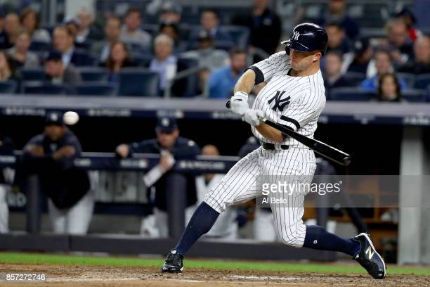 Brett Gardner of the New York Yankees hits a home run against Ervin Santana of the Minnesota Twins during the second inning in the American League...