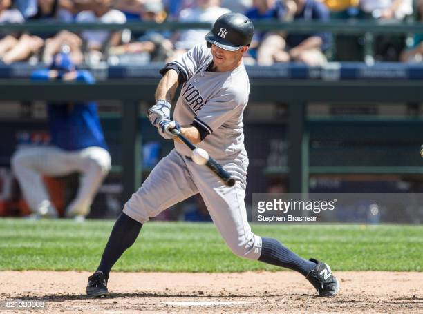 Brett Gardner of the New York Yankees hits a RBIsingle off of relief pitcher James Pazos of the Seattle Mariners to score Chase Headley of the New...
