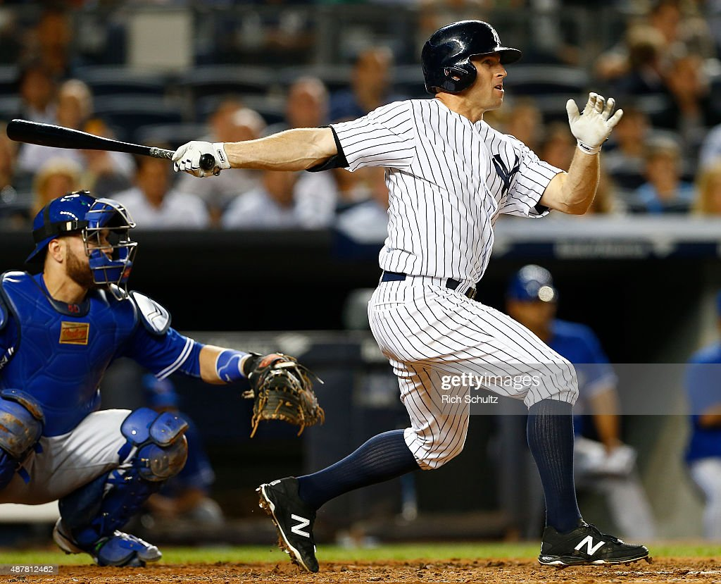 Brett Gardner #11 of the New York Yankees hits a sacrifice fly that scores a run in the third inning against the Toronto Blue Jays during a MLB baseball game at Yankee Stadium on September 11, 2015 in the Bronx borough of New York City.