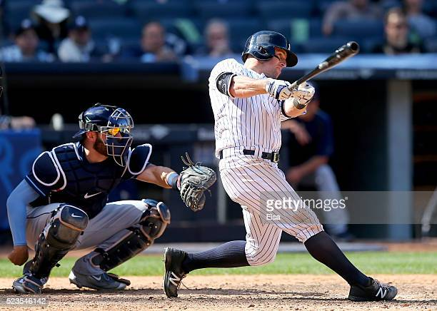 Brett Gardner of the New York Yankees hits a solo home run as Curt Casali of the Tampa Bay Rays defends in the bottom of the ninth inning to win the...